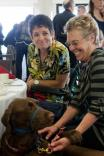 Julie Stein, affected with LOTS, (left), Ellen Martin (right), and helping dog, Basil, enjoying themselves at the LOTS charity benefit.